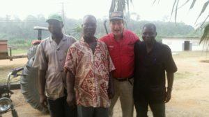 Palm Oil Cote d'Ivoire (Ivory Coast) - AgriSmart, Inc. Chairman, H. David Meyers with palm oil workers in Côte d'Ivoire